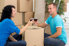 Happy couple celebrating moving to new house with champagne Stock Photo