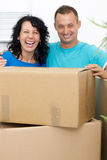 Happy couple celebrating moving to new house Royalty Free Stock Images