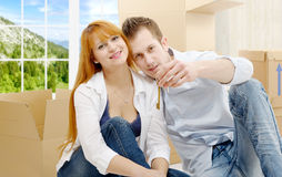 Happy couple celebrating their new home, keys in hand. Royalty Free Stock Image