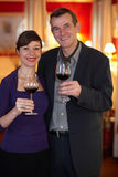 Happy Couple Celebrating With Wine Royalty Free Stock Photography