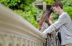 Happy couple in Central Park. Couple talking and having fun on Bow Bridge in Central park in New York City stock images