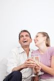 Happy Couple with Champagne Flutes Stock Photos