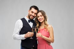 Happy couple with champagne glasses toasting stock photos