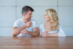 Happy couple chatting over morning coffee Stock Photography