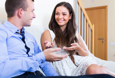 Happy couple chatting. Portrait of happy young couple chatting and laughing in domestic interior royalty free stock photography
