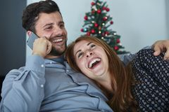 Happy couple chatting on smartphone Stock Photography