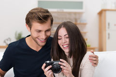 Happy couple checking a photo on their camera Stock Photo