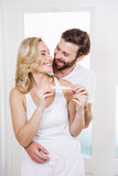 Happy couple checking pregnancy test Royalty Free Stock Photography