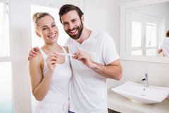 Happy couple checking pregnancy test Stock Image