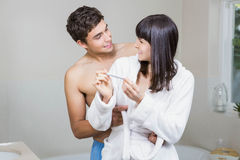 Happy couple checking results of pregnancy test Stock Photos