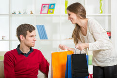 Happy couple checking shopping bags in the living room Royalty Free Stock Images
