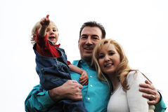 Happy couple with a child Stock Photos