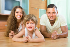 Happy couple with child at home Stock Photo