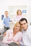 Happy couple with children Stock Photo
