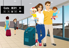 Happy couple with children in an airport Royalty Free Stock Photo
