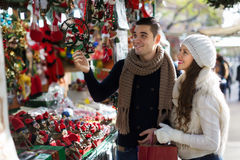 Happy  couple  choosing Christmas souvenirs Royalty Free Stock Photo