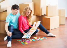 Happy couple choosing colors in their new home Royalty Free Stock Image