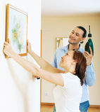 Happy  couple choosing place for picture in frame Royalty Free Stock Photo