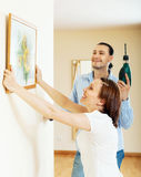 Happy  couple choosing place for picture in frame Stock Image