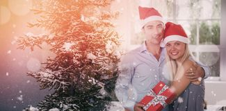 Composite image of happy couple at christmas Stock Photos