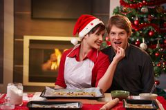 Happy couple with christmas cake Royalty Free Stock Image