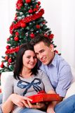 Happy couple at Christmas day Stock Photos