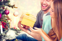 Happy Couple with Christmas Gift stock photography