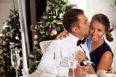Happy Couple with Christmas Gift at Home. Royalty Free Stock Photo