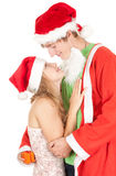 Happy couple in a Christmas hats Royalty Free Stock Photography