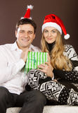 Happy couple in Christmas hats Stock Images