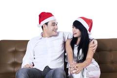 Happy couple in christmas hats Stock Image