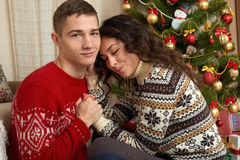 Happy couple with christmas and new year gift at home. Fir tree with decoration. Winter holiday concept. Smiling family together. stock photos
