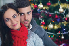 Happy couple at Christmas night. Beautiful couple at Christmas night stock photo