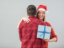 Happy couple with christmas present Royalty Free Stock Photography