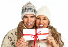 Happy couple with christmas present. Royalty Free Stock Image