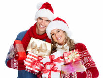 Happy couple with christmas present. Royalty Free Stock Images