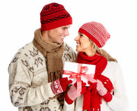 Happy couple with christmas present. Royalty Free Stock Photography