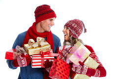 Happy couple with christmas present. Royalty Free Stock Photo