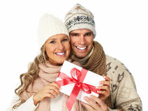 Happy couple with christmas present. Stock Photo