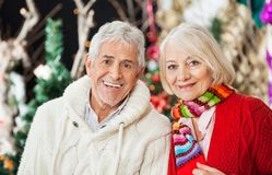Happy Couple At Christmas Store Royalty Free Stock Photography