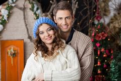 Happy Couple In Christmas Store Stock Image