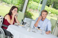Happy couple at classy restaurant. Happy couple at the classy restaurant Stock Photography