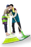 Happy couple cleaning the floor isolated Royalty Free Stock Images