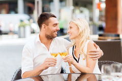 Happy couple clinking glasses at restaurant lounge Stock Photo