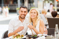 Happy couple clinking glasses at restaurant lounge Royalty Free Stock Photography