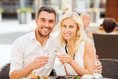 Happy couple clinking glasses at restaurant lounge Stock Images