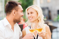 Happy couple clinking glasses at restaurant lounge Royalty Free Stock Photos