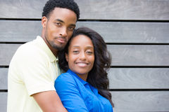 Happy couple. Closeup portrait of a young couple, guy in yellow shirt holding women with blue shirt from behind, happy moments, positive human emotions on Stock Photos