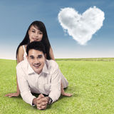 Happy couple with clouds shaped of heart Stock Photography