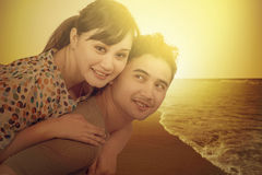 Happy couple at coast with instagram filter Royalty Free Stock Image